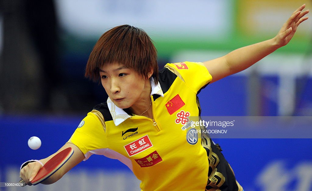 Liu Shiwen of China returns a service to Katarzyna Grybowska during their women's teams group A match at the 2010 World Team Table Tennis Championships in Moscow on May 25, 2010.