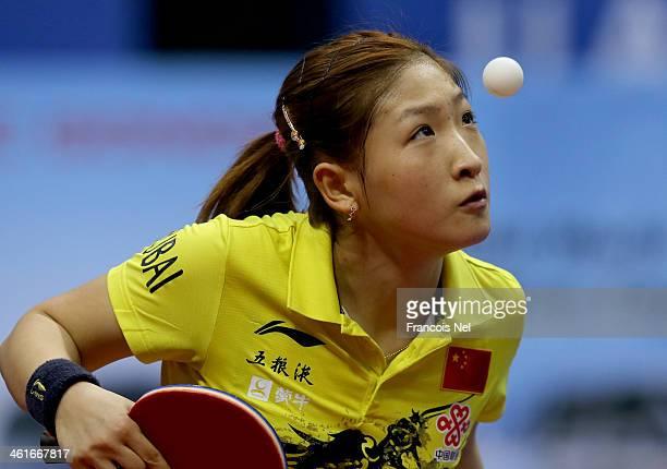 Liu Shiwen of China serves to Jeon Jihee of Korea during the GAC Group 2013 ITTF World Tour Grand Finals at the Al Nasr Sports Club on January 10,...