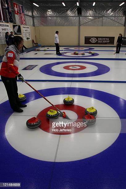 Liu Sijia of China inspects the head during the Curling Round Robin match between China and Latvia on day eight of the Winter Games NZ at Maniototo...
