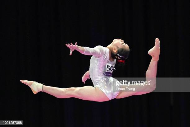 Liu Tingting of China competes on the Balance Beam during the Artistic Gymnastics of the Women's Team Final at the Jiexpo Hall on day four of the...