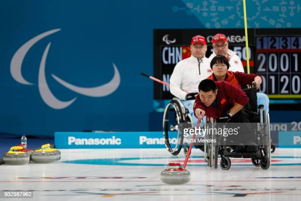 Liu Wei of China delivers a stone during the Curling Mixed Golden Medal match between China and Norway during day eight of the PyeongChang 2018...