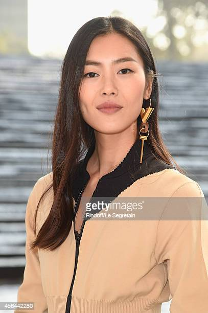 Liu Wen attends the Louis Vuitton show as part of the Paris Fashion Week Womenswear Spring/Summer 2015 on October 1 2014 in Paris France
