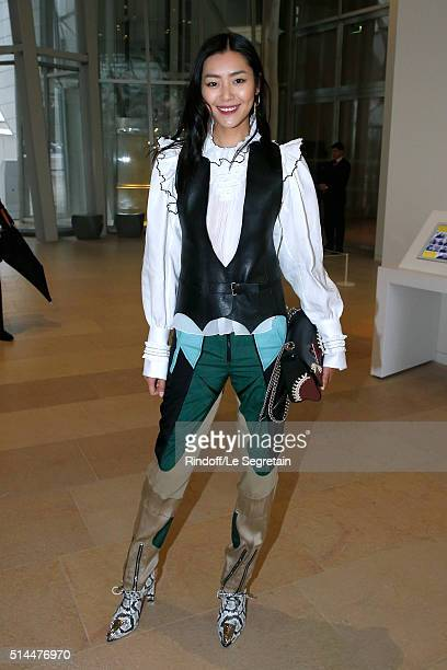 Liu Wen attends the Louis Vuitton show as part of the Paris Fashion Week Womenswear Fall/Winter 2016/2017 Held at Louis Vuitton Foundation on March 9...