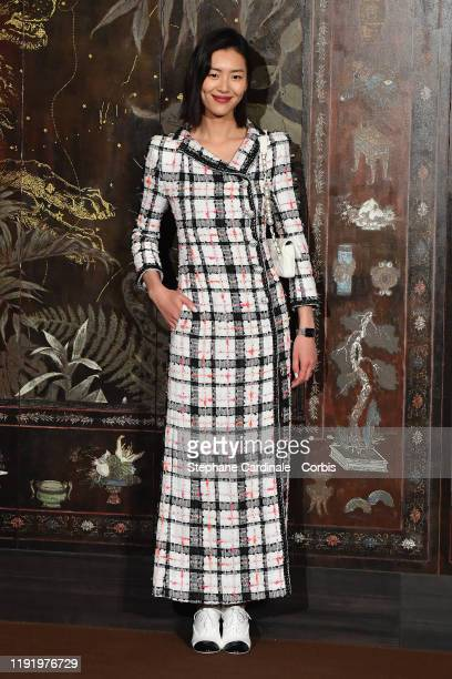 Liu Wen attends the photocall of the Chanel Metiers d'art 20192020 show at Le Grand Palais on December 04 2019 in Paris France
