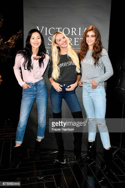 Liu Wen Candice Swanpoel and Taylor Hill pose at the Victoria's Secret Store At Lippo Plaza Appearance at Victoria's Secret on November 18 2017 in...