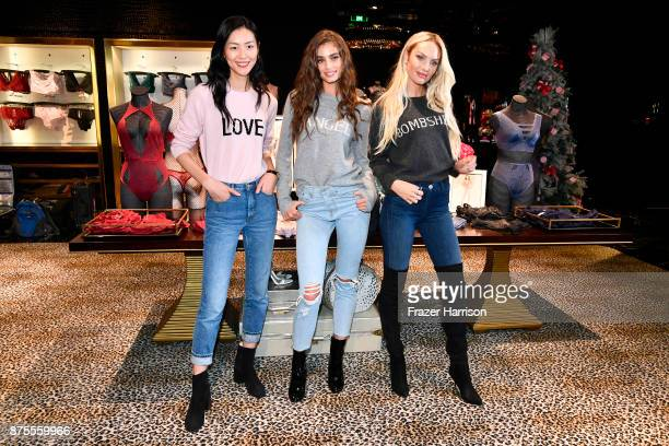 Liu Wen Taylor Hill and Candice Swanpoel pose at the Victoria's Secret Store At Lippo Plaza Appearance at Victoria's Secret on November 18 2017 in...