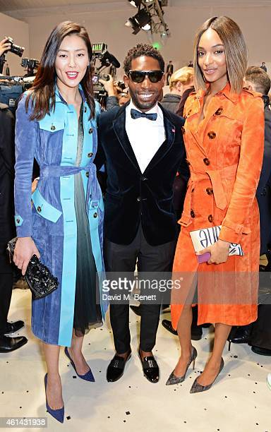 Liu Wen Tinie Tempah and Jourdan Dunn pose backstage at Burberry Prorsum AW15 London Collections Men at Kensington Gardens on January 12 2015 in...