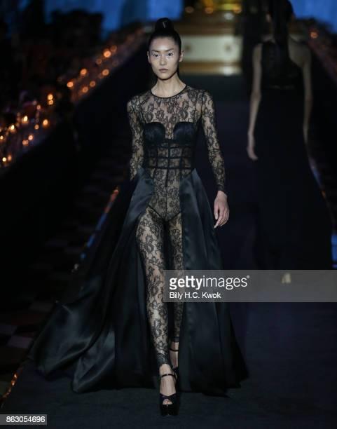 Liu Wen walks on the runway during La Perla Spring/Summer 2018 Collection at The Sands Macao Fashion Week on October 19 2017 in Macau Macau