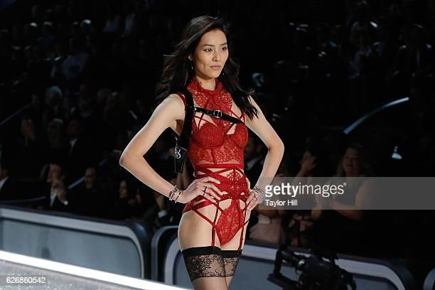 Liu Wen walks the runway during the 2016 Victoria's Secret Fashion Show at Le Grand Palais on November 30 2016 in Paris France