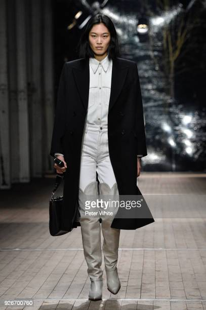 Liu Wen walks the runway during the Isabel Marant show as part of the Paris Fashion Week Womenswear Fall/Winter 2018/2019 on March 1 2018 in Paris...