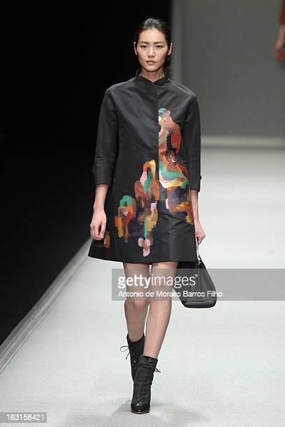 Liu Wen walks the runway during the Shiatzy Chen Fall/Winter 2013 ReadytoWear show as part of Paris Fashion Week on March 5 2013 in Paris France