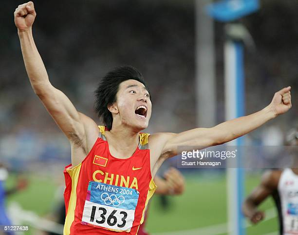 Liu Xiang of China celebrates after he finished first in the men's 110 metre hurdle final on August 27 2004 during the Athens 2004 Summer Olympic...