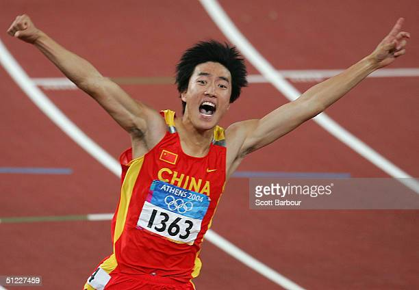 Liu Xiang of China celebrates after he finished first in the men's 110 metre hurdle final on August 27, 2004 during the Athens 2004 Summer Olympic...