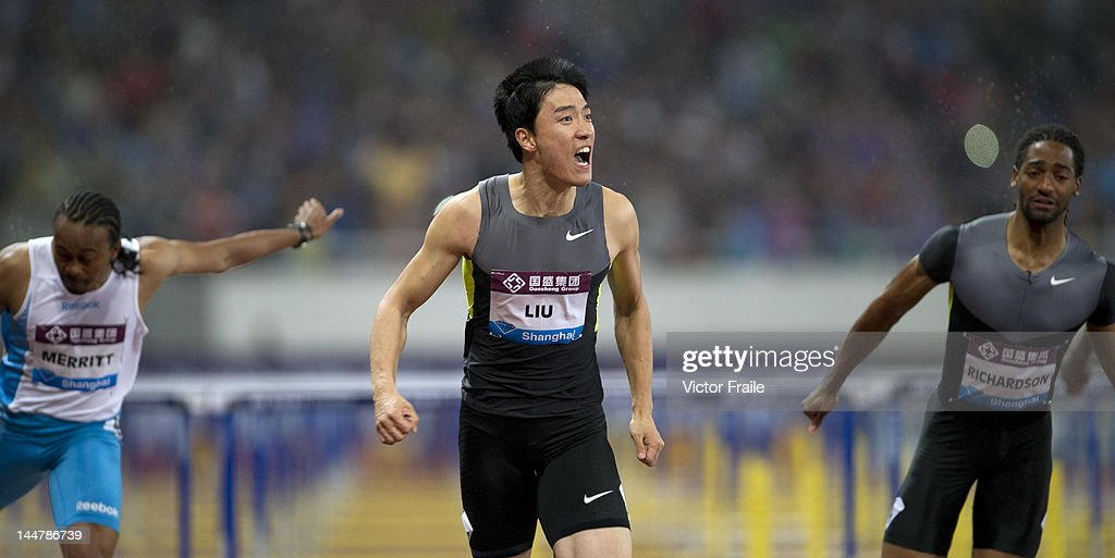 Liu Xiang of China (C) celebrates after winning the Men's 110m Hurdles against Aries Merritt of the USA (L) and Jason Richardson of the USA (R) on May 19, 2012 at the Shanghai Stadium in Shanghai, China.