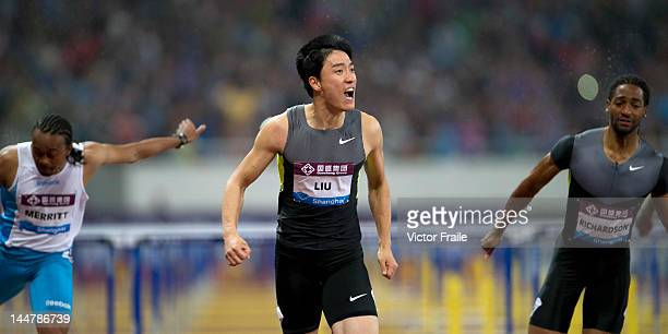Liu Xiang of China celebrates after winning the Men's 110m Hurdles against Aries Merritt of the USA and Jason Richardson of the USA on May 19 2012 at...