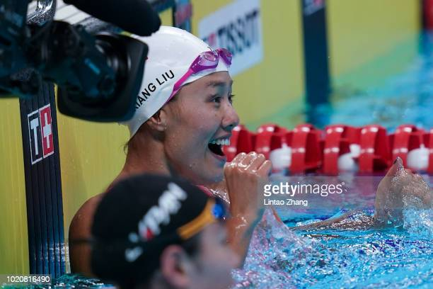 Liu Xiang of China celebrates breaking the new world record to win the women's 50m backstroke swimming event on day three of the Asian Games on...
