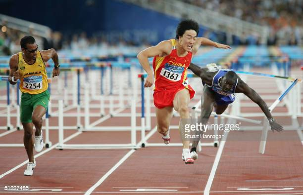 Liu Xiang of China crosses the finish line as he finished first in the men's 110 metre hurdle final on August 27 2004 during the Athens 2004 Summer...