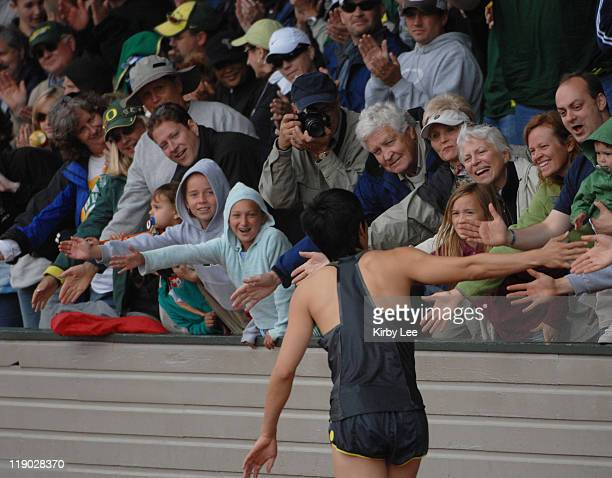 Liu Xiang of China is greeted by fans after winning the 110meter hurdles in 1323 in the Prefontaine Classic at the University of Oregon's Hayward...