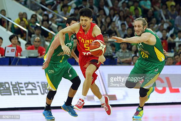 Liu Xiao-Yu of China in action against Jesse Wagstaff of the NBL All Australian Team during Internationl Basketball Challenge match between the...