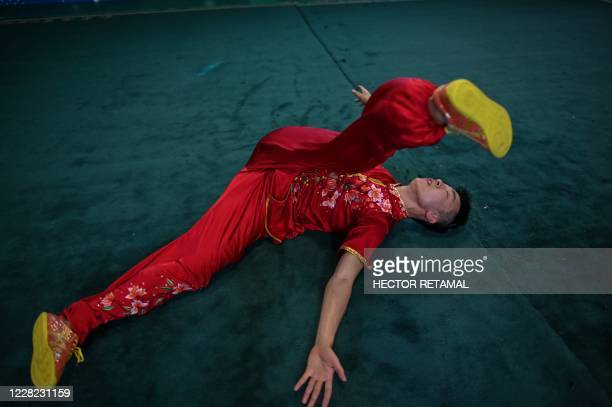 Liu Xuliang practices drunken boxing in Shanghai on August 24 2020 Liu Xuliang lunges menacingly as if spoiling for a fight after too many drinks But...