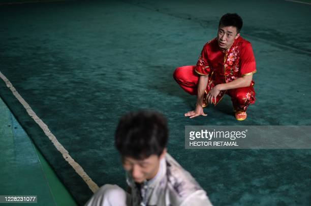 Liu Xuliangand his mate take a rest after practicing drunken boxing in Shanghai on August 24 2020 Liu Xuliang lunges menacingly as if spoiling for a...