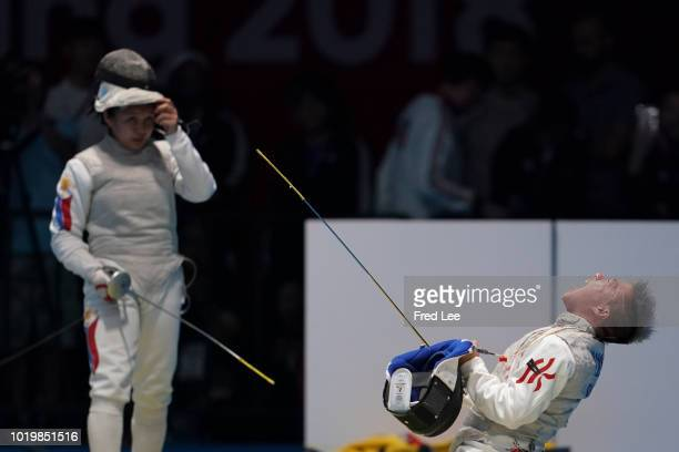 Liu Yan Wai of Hong Kong celebrates during Women's Foil Individual Round of 16 on day two of the Asian Games on August 20, 2018 in Jakarta, Indonesia.