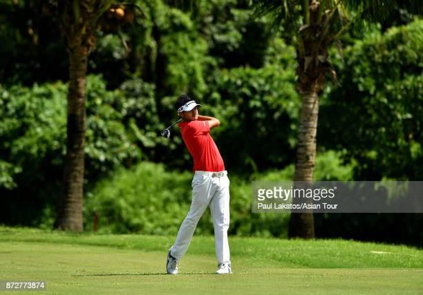 Liu Yanwei of China plays a shot during round three of the Resorts World Manila Masters at Manila Southwoods Golf and Country Club on November 11...
