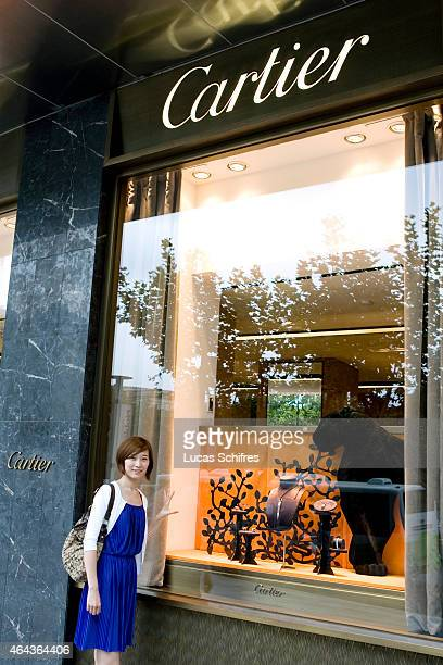 Liu Yi in front of a Cartier store part of Plaza 66 shopping mall on September 15 2009 in Shanghai China