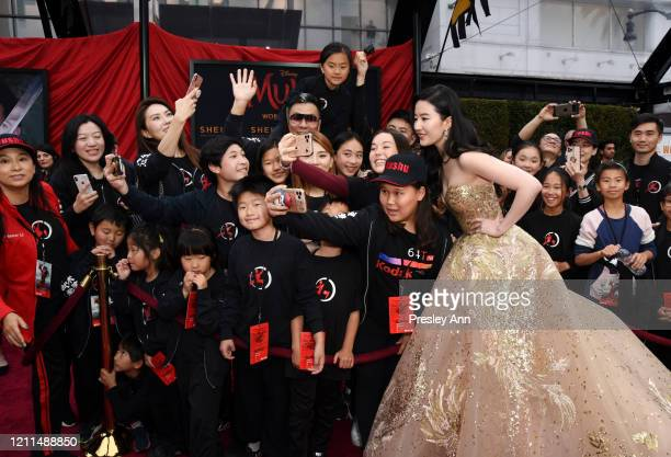 Liu Yifei attends Disney's Mulan World Premiere Red Carpet Fan Pen at Dolby Theatre on March 09 2020 in Hollywood California