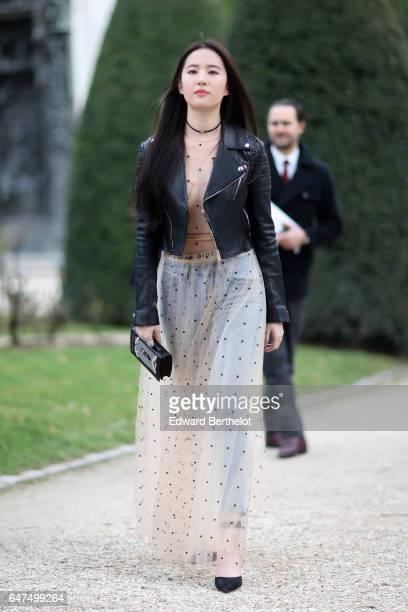 Liu Yifei attends the Christian Dior show as part of the Paris Fashion Week Womenswear Fall/Winter 2017/2018 on March 3 2017 in Paris France