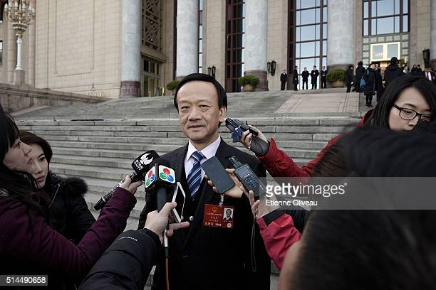 Liu Yiliang, Macao delegate, answers journalists after the Second Plenary Meeting of the National People's Congress, on March 9, 2016 in Beijing,...