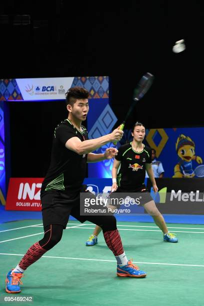 Liu Yuchen and Tang Jinhua of China compete against Hee Yong Kai Terry and Tan Wei Han of Singapore during Mixed Doubles Round 1 match of the BCA...