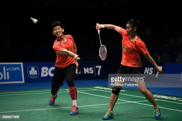Liu Yuchen and Tang Jinhua of China compete against Zheng Siwei and Chen Qingchen of China during Mixed Double Semifinal match of the BCA Indonesia...