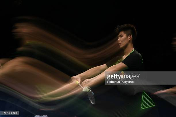Liu Yuchen of China serves against Mathias Boe and Carsten Mogensen of Denmark during Men's Double Final match of the BCA Indonesia Open 2017 at...