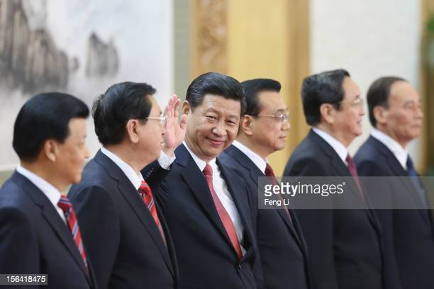 Liu Yunshan Zhang Dejiang Xi Jinping Li Keqiang Yu Zhengsheng and Wang Qishan greet the media at the Great Hall of the People on November 15 2012 in...
