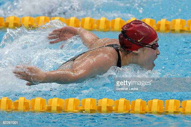 Liu Zige of China celebrates competes in the Women's 200m Butterfly Final in first place and wins the gold medal at the National Aquatics Centre...