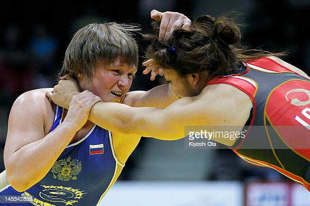 Liubov Volosova of Russia competes against Kaori Icho of Japan in the 63kg division of the final match between Japan and Russia during day two of the...