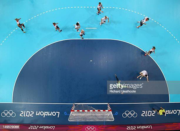 Liudmila Postnova of Russia scores past Sarah Hargreaves of Great Britain in the Women's Preliminaries Group A Match 9 between Great Britain and...