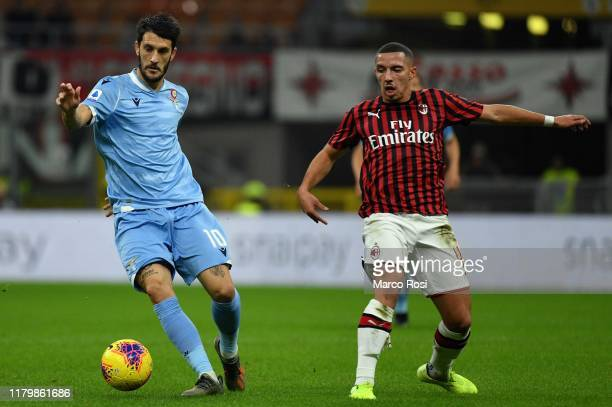 Liuis Albero of SS Lazio compete for the ball with Ismael Bennacer of AC Milan during the Serie A match between AC Milan and SS Lazio at Stadio...