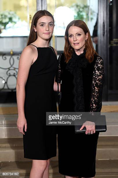 Liv Freundlich and Julianne Moore attend the Ralph Lauren fashion show during New York Fashion Week The Shows at Skylight Clarkson Sq on September 14...