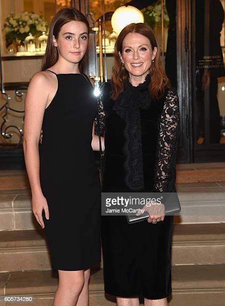 Liv Freundlich and Julianne Moore attend the Ralph Lauren fashion show during New York Fashion Week The Shows at Ralph Lauren Madison Avenue Store on...