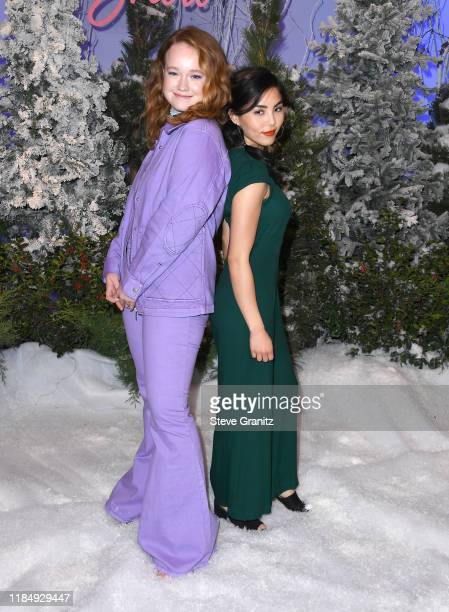 Liv Hewson and Anna Akana arrives at the Photocall For Netflix's Let It Snow at the Beverly Wilshire Four Seasons Hotel on November 01 2019 in...