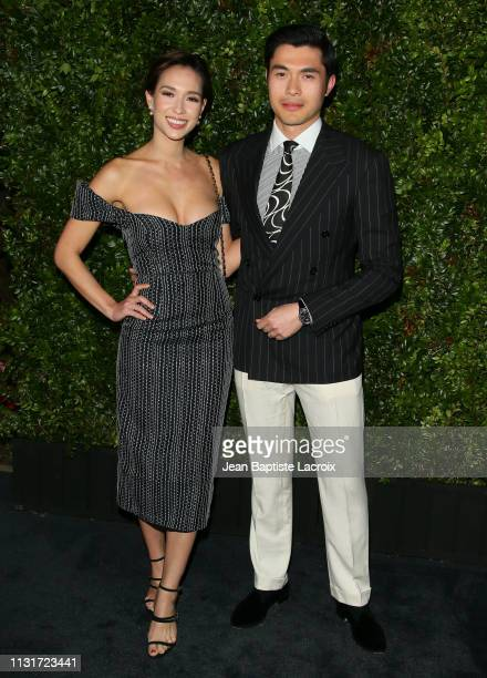 Liv Lo and Henry Golding attend Charles Finch And CHANEL's 11th Annual PreOscar Awards Dinner at Polo Lounge at The Beverly Hills Hotel on February...