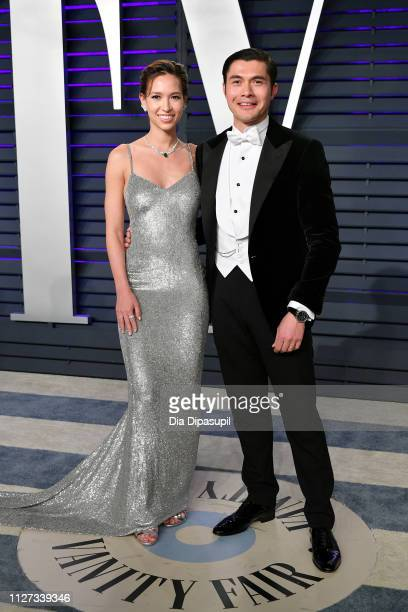 Liv Lo and Henry Golding attend the 2019 Vanity Fair Oscar Party hosted by Radhika Jones at Wallis Annenberg Center for the Performing Arts on...