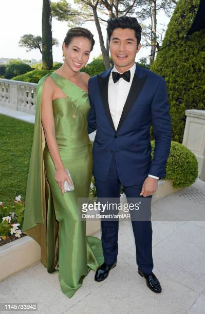 Liv Lo Golding and Henry Golding attend the amfAR Cannes Gala 2019 at Hotel du CapEdenRoc on May 23 2019 in Cap d'Antibes France
