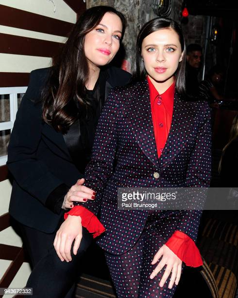 Liv Tyler and Bel Powley attend The Cinema Society Gemfields host the after party for IFC Midnight's 'Wildling' at Alley Cat Amateur Theatre at The...