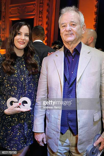 Liv Tyler and Bill Murray pose on stage at the GQ Men of the year Award 2016 show at Komische Oper on November 10 2016 in Berlin Germany
