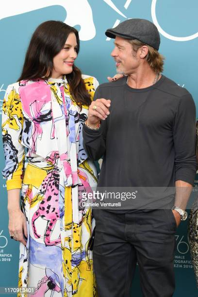 Liv Tyler and Brad Pitt attend Ad Astra photocall during the 76th Venice Film Festival at Sala Grande on August 29 2019 in Venice Italy