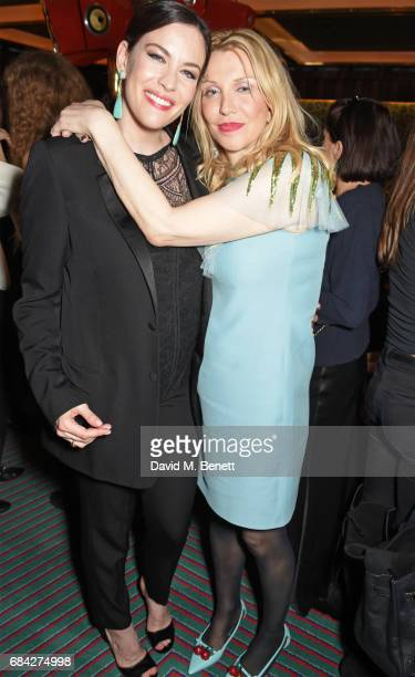 Liv Tyler and Courtney Love attend a private dinner celebrating the launch of the KATE MOSS X ARA VARTANIAN collection at Isabel on May 17 2017 in...