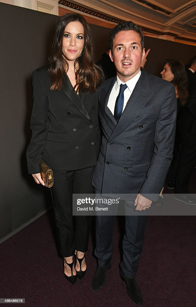 Liv Tyler (L) and Dave Gardner attend a drinks reception at the British Fashion Awards in partnership with Swarovski at the London Coliseum on November 23, 2015 in London, England.